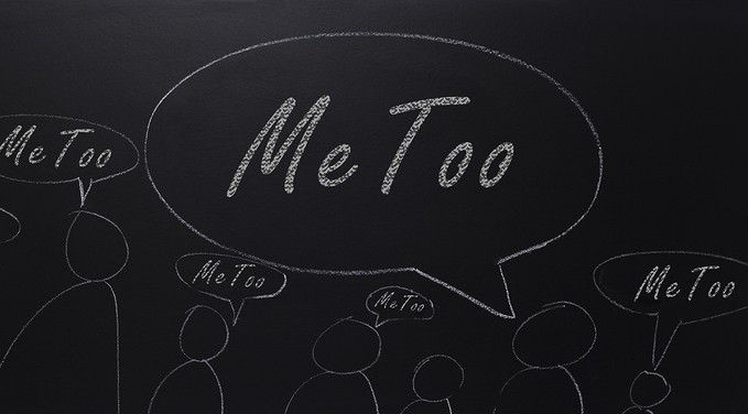 Sexual harassment concept. me too Text written on blackboard.